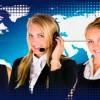3 women wearing headsets in a call center world map in the background