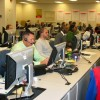 Call center with numerous people answering telephone calls.