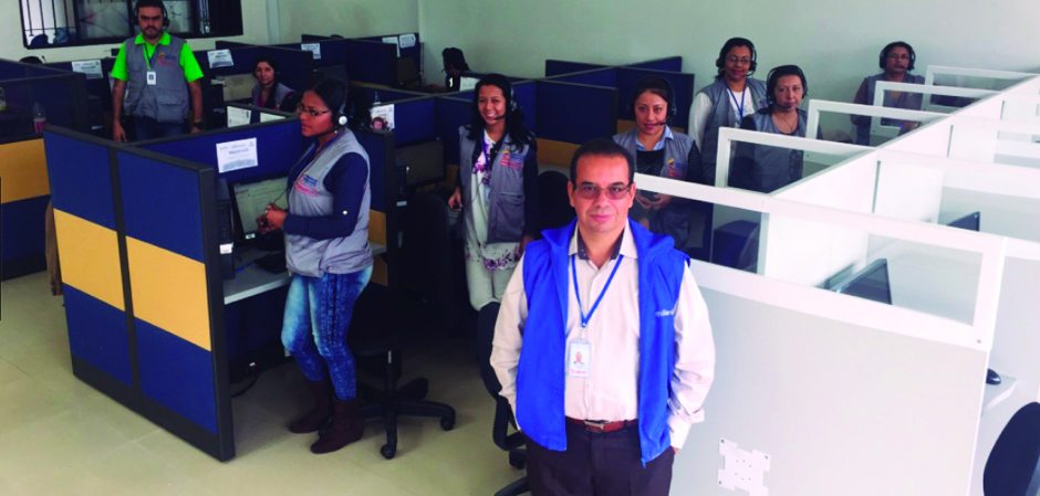 Man leading a group of women in a call center